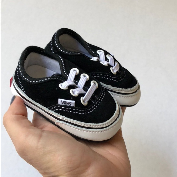 a1927d2904 Black Vans tiny baby shoes. M 5a79f87445b30c2ef47e09f8